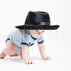 Baby Crawling Wearing a Black Fedora
