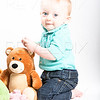 Baby Kneeling with Teddy Bear On White