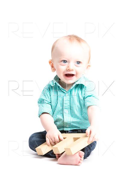 Baby Smiling Sitting Holding Letter E