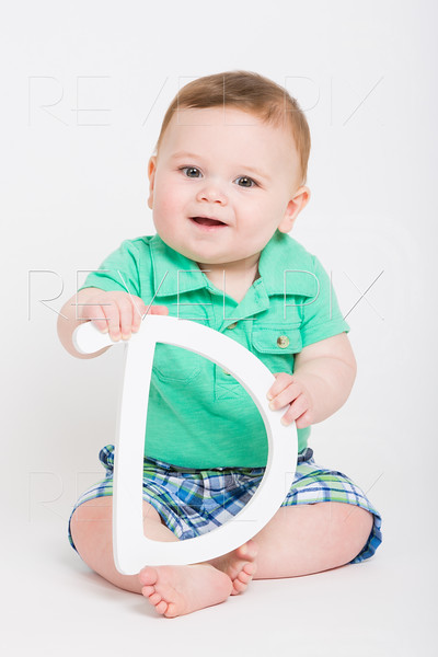 Baby Holding Letter D Smiling