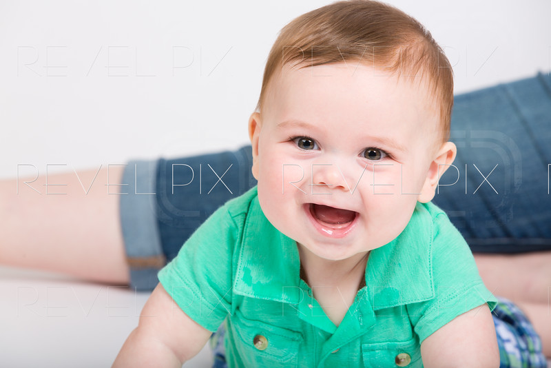 Baby Smiles on Stomach in Clothes