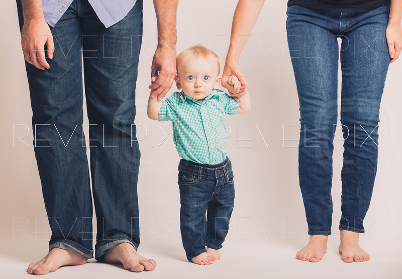 Baby Holding Parents Hands Eyes Wide