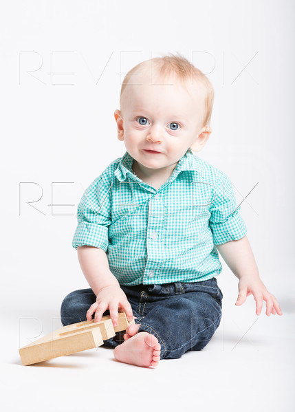 Baby Sitting Smiling at Camera