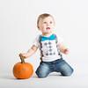 Baby on Knees Holding Pumpkin Stem