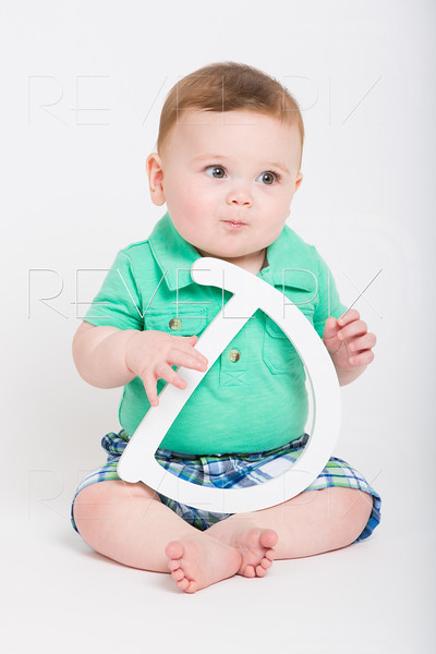Baby Holding Letter D Looking Right