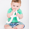 Baby Puts Letter A in His Mouth