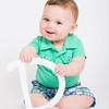 Baby Holding Letter D Smirk