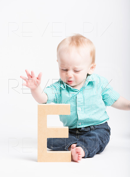 Baby Reaching for Wooden Letter E