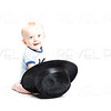 Baby on White Reaching into a Black Hat
