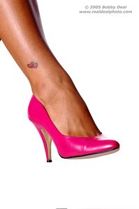 Lower calf and foot in a smart and sexy pink pump