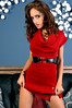 Sexy young party girl in a red knit dress and black leather empire waist belt