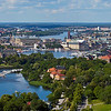 View over Stockholm from the tower of Kaknästornet<br /> From left - moderna museum, Royal Palace, Parlament, City Hall. <br /> Background Riddarfjärden and Västerbron.