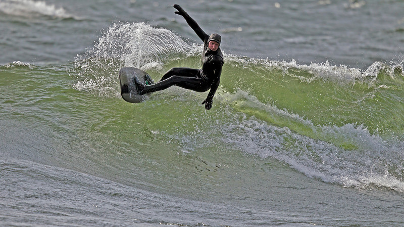 Surfer in just +4 degrees C water