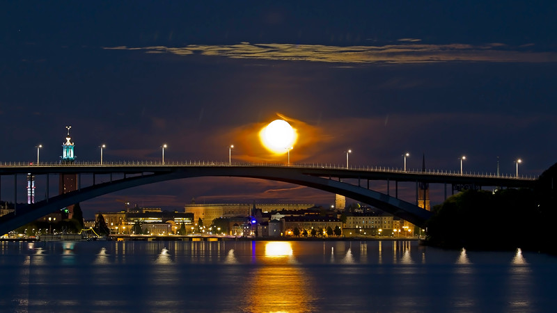 Full moon in Stockholm city<br /> Västerbron with city hall, Royal palace Stockholm and the moon