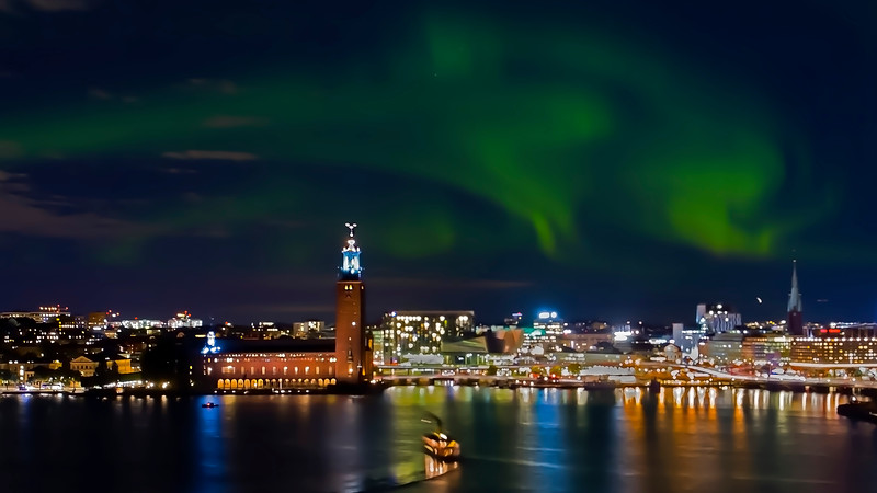 Aurora (Nordic light) over Stockholm city hall.<br /> It's extremely unusual to see the aurora in Stockholm. You must travel  further north in Sweden.