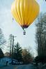 Hot air balloon close to landing in street
