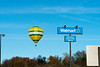 Hot air balloon flying over Walmart