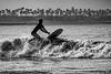 Man losing control of surfboard
