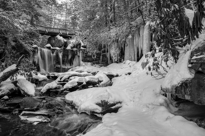 Beautiful waterfall in the wintertime with ice and snow bw