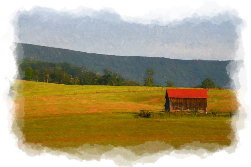Barn in country on rolling hill