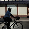 silhouette man on bike
