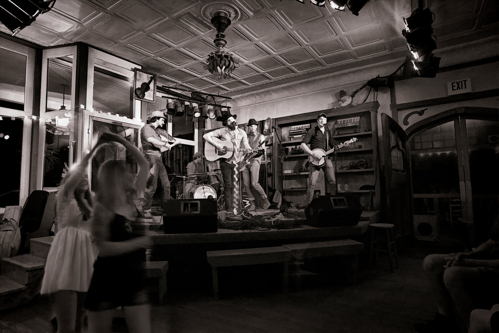 Two girls dancing at the Purple Fiddle with Bryan Elijah Smith and the Wild Heart Band