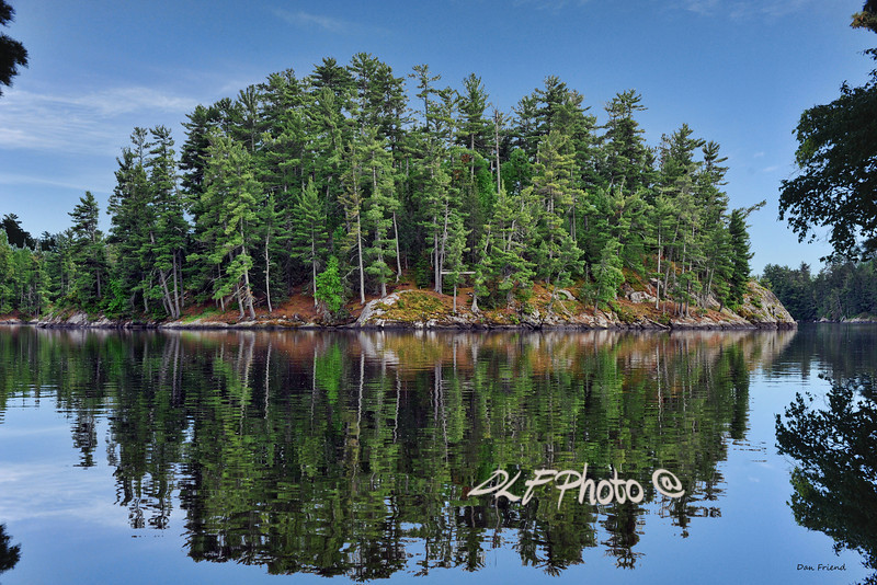 "Reflection island Lake of Woods Canada<br /> <br /> to purchase - <a href=""http://dan-friend.artistwebsites.com/featured/island-at-lake-of-woods-at-canada-dan-friend.html"">http://dan-friend.artistwebsites.com/featured/island-at-lake-of-woods-at-canada-dan-friend.html</a>"