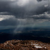 Rain falling in distance on mountain