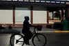 silhouette woman on bike