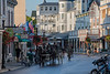 Downtown Mackintac in morning with horses and bikes