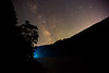 Boat lights in Cheat Lake under the Milky Way