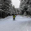In line skiing down the snow trail