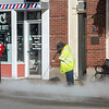 Cleaning the sidewalks in the city