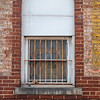 Rusted bars on window