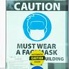 Must wear mask sign on door