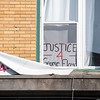 Justice for George Floyd sign in window