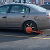 Car with boot on it in parking lot