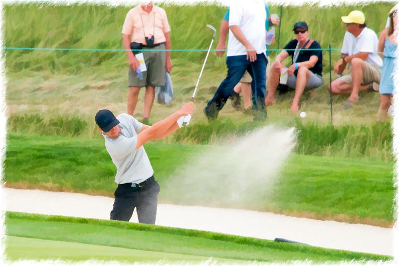 Sand and golf ball flying