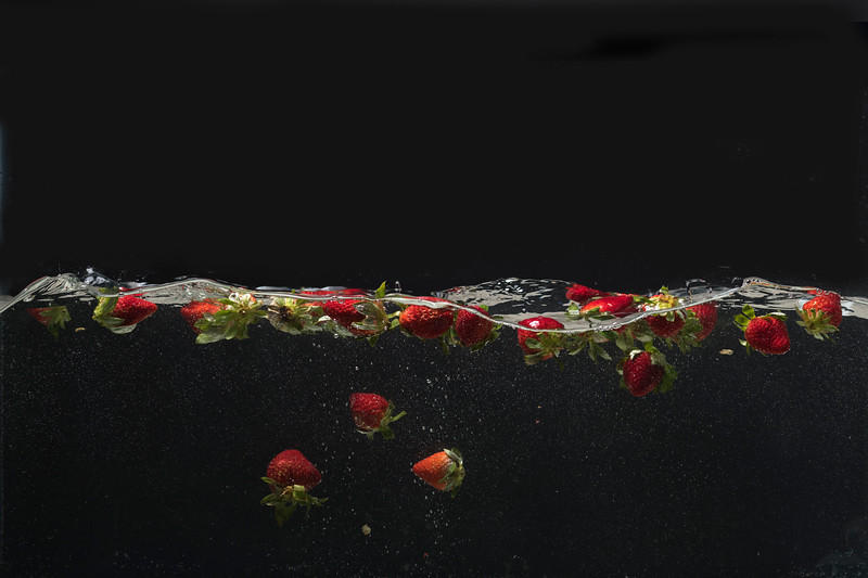 Strawberries floating on and under the water