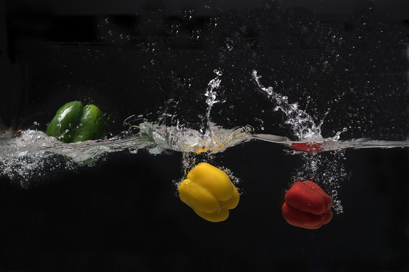 Green yellow and red pepper swimming