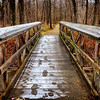 Old bridge with footpath on the snow. Added vignetting.