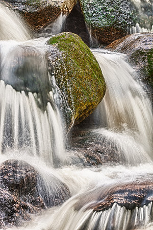 Cascade with fresh flowing water and rock stone. Moss on the stone. HDR photography.