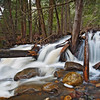 Beautiful cascade in the forest from Cap Tourmente Reserve Quebec Canada. Flowing water with stone.