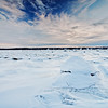 winter scene with snow and beautiful cloudy sky. Large depth of field with hyperfocal use.