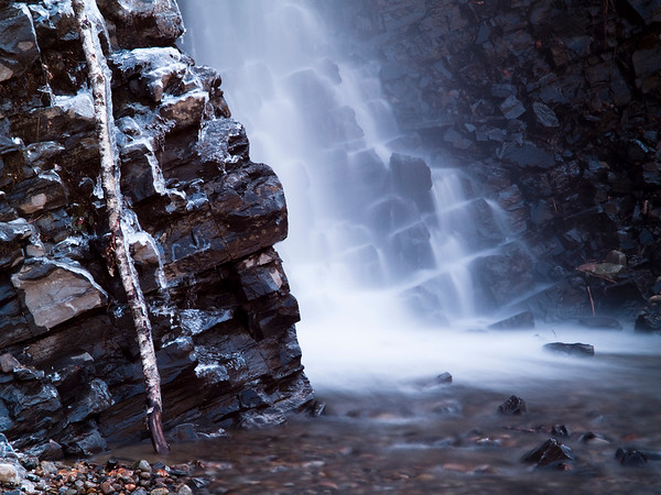beautiful water cascade with rock and stone
