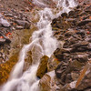 Beautifull water cascade with flowing water and rocks.