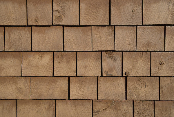 Brown stained cedar shingle background