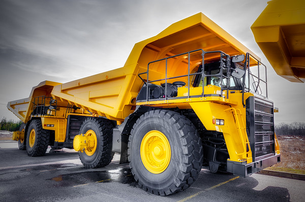 Large haul truck ready for big job in a mine. Low salturation and added vigneting.