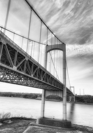 Suspension bridge from quebec canada during spring season. Black and white photography.