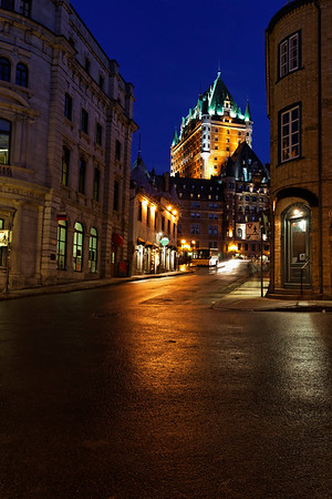Castle frontenac from a street during the night
